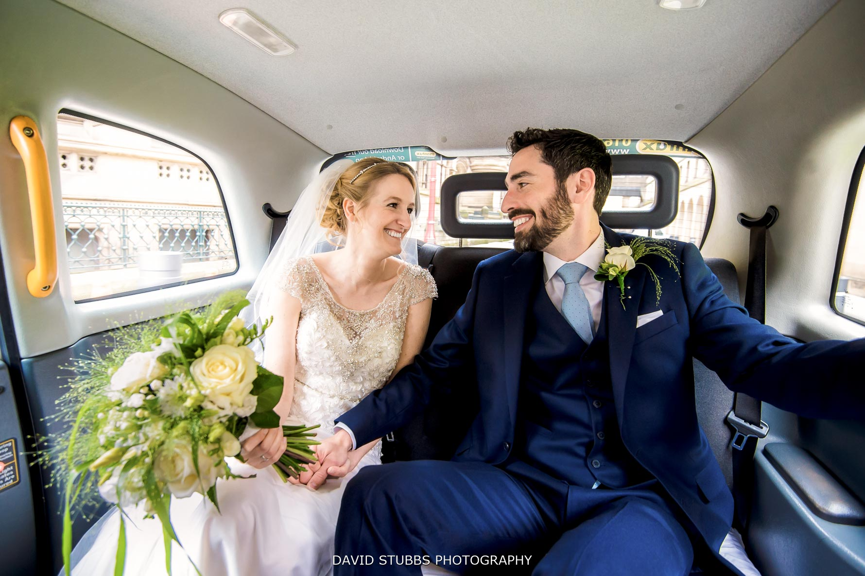 arriving in the car for their wedding at Great John Street Hotel