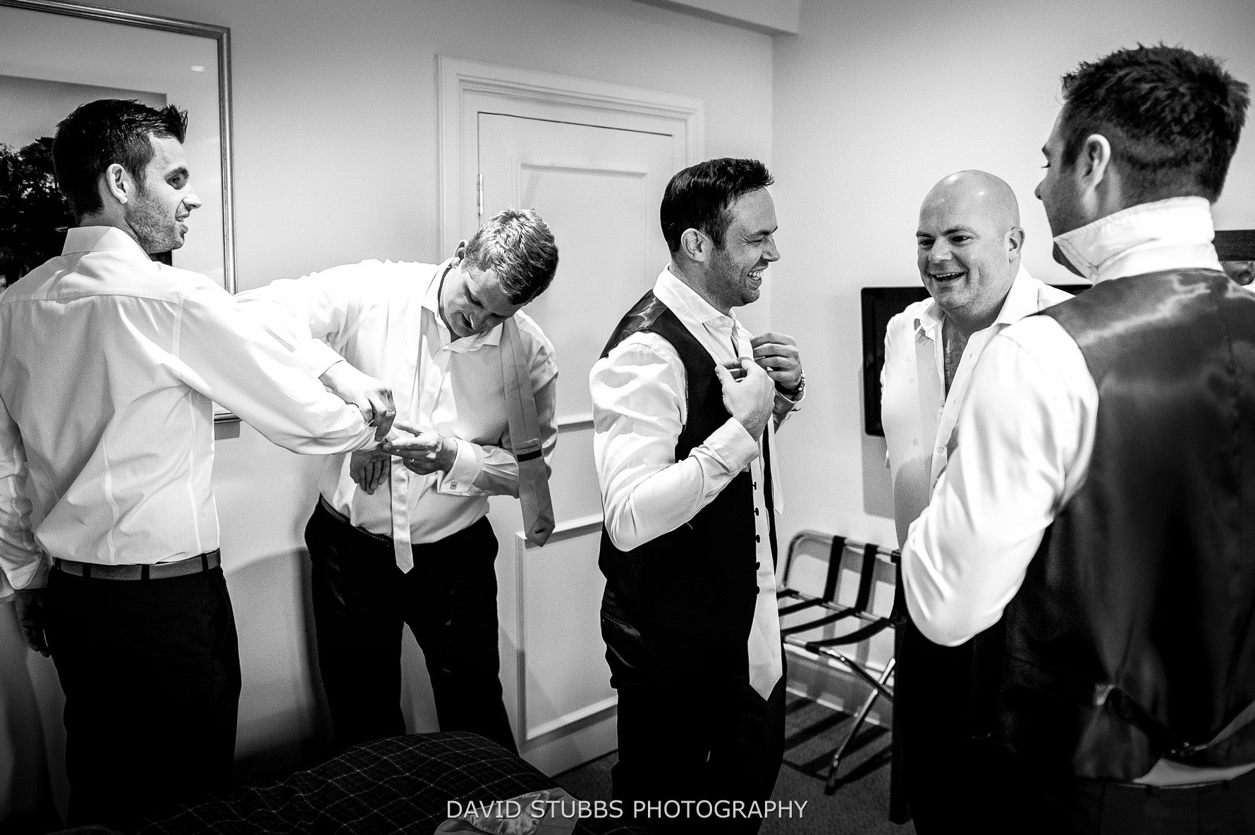 groomsmen laughing and joking