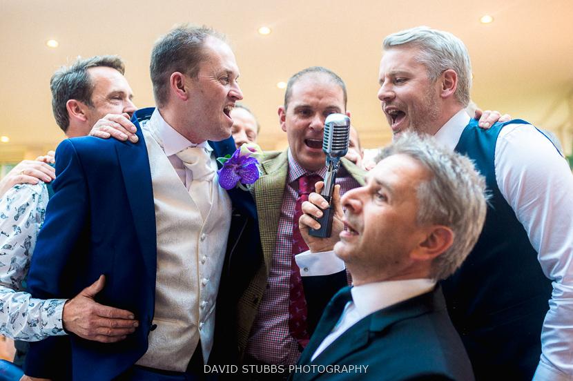 men gathered round mic