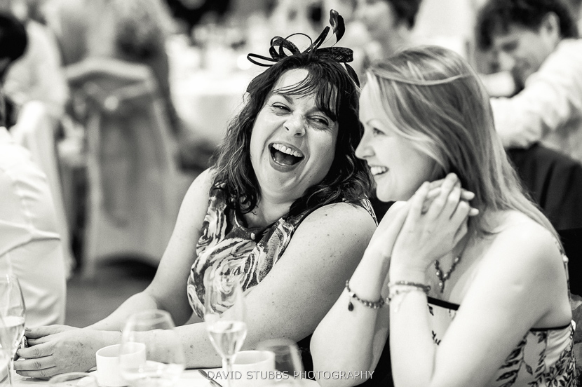 woman laughing black and white