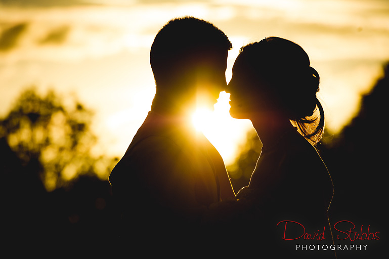 bride and groom with sun