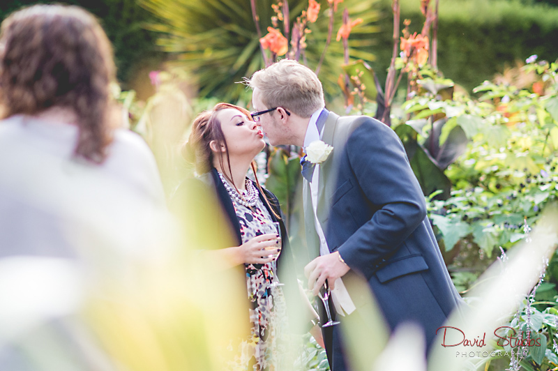 guests kissing outside