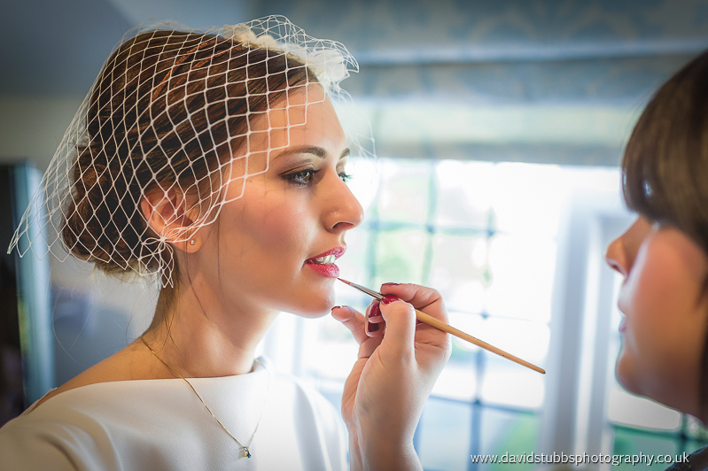 make up artist at work at wedding