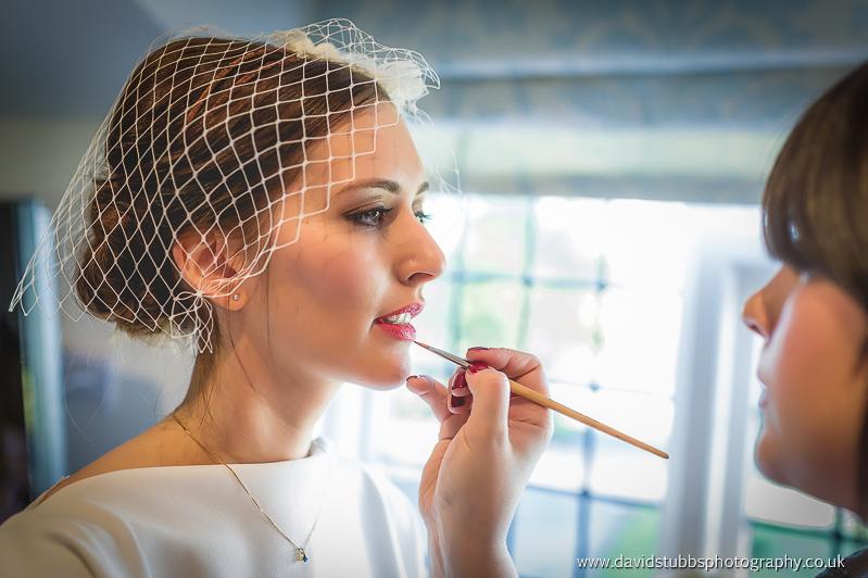 make up artist at work at wedding