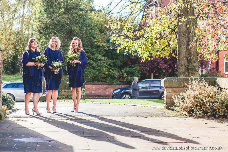 bridesmaids waiting outside the church