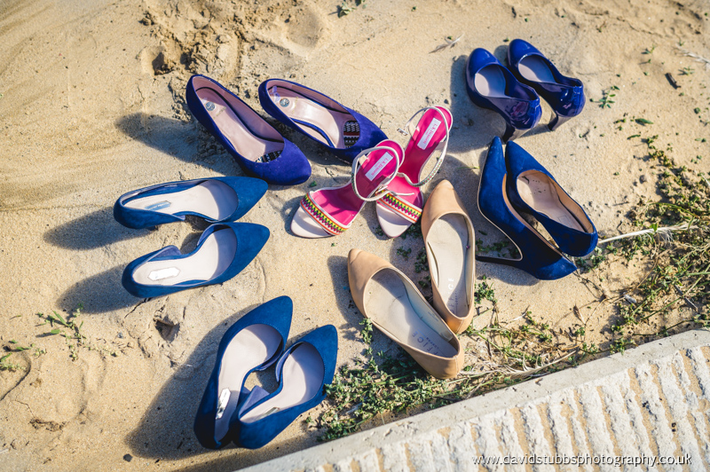 bridesmaids shoes on the beach