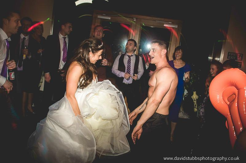 groom shirt off dancing