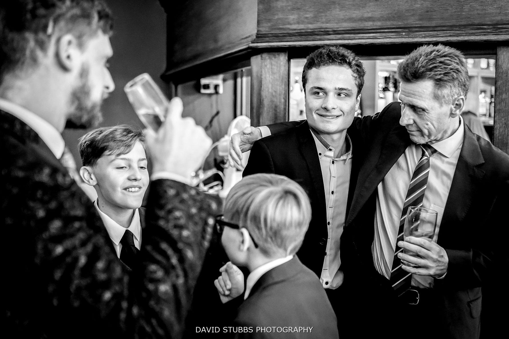 wedding guests waiting at the bar
