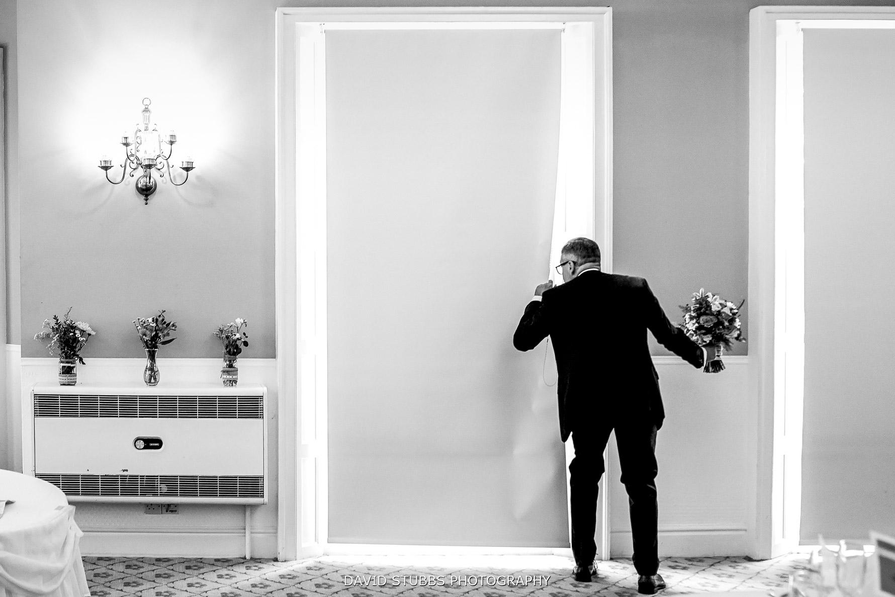 dad peeking through the curtains