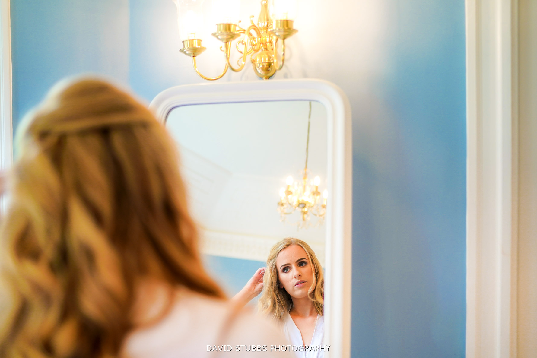 bride reflection in mirror in colour