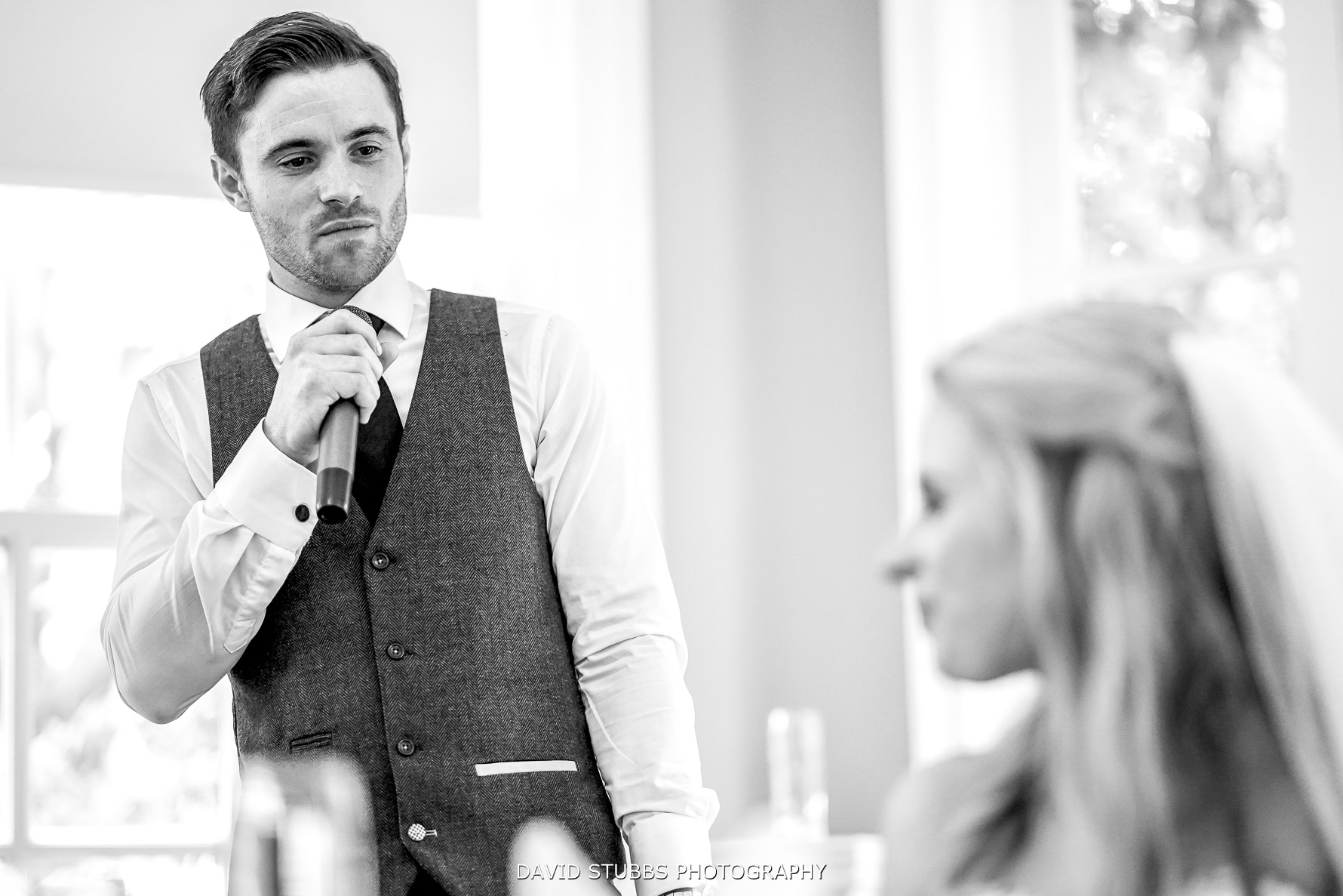 emotional groom during the speeches