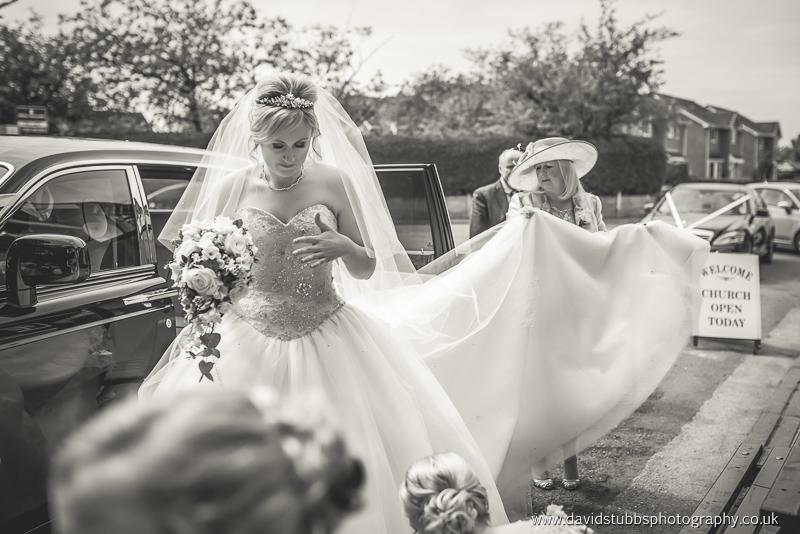 bride arriving int he car