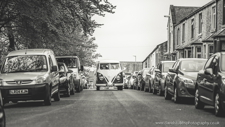 vw campervan arriving with bridesmaids