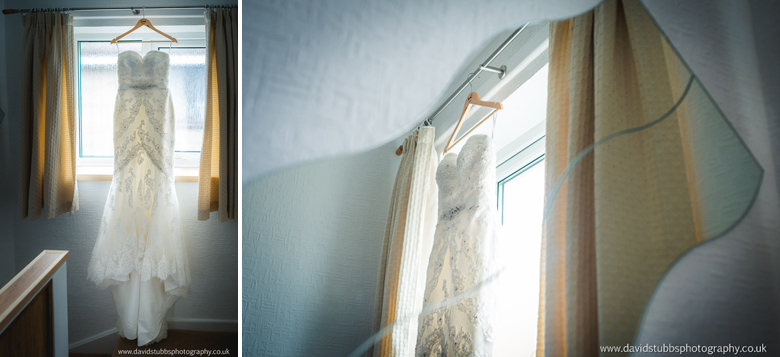 wedding dress hanging up in mirror