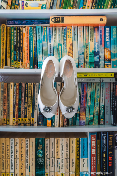 shoes on book case
