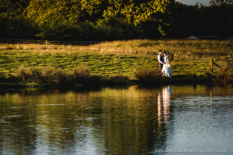 couple stood by the lake at Sandhole Cheshire