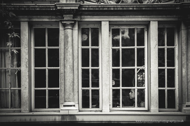 black and white bride in window