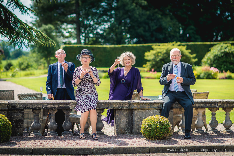 guests drinking in hall grounds