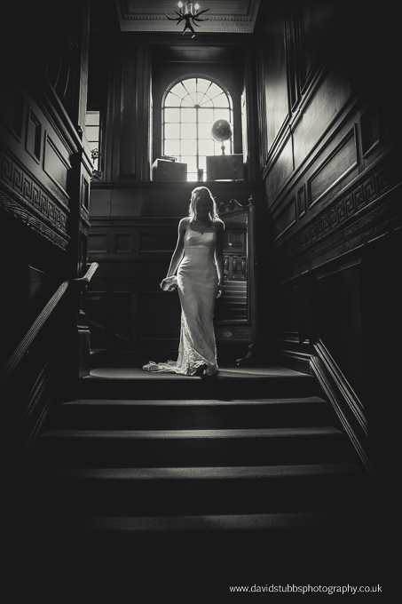bride on stairs eaves hall