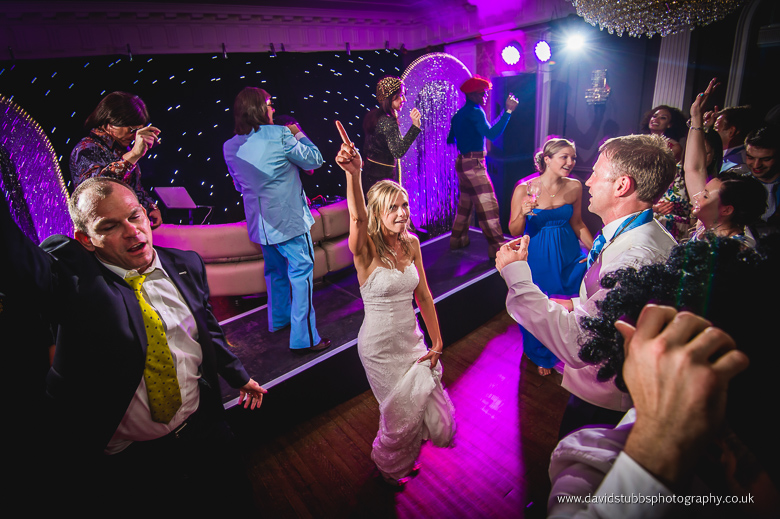 bride dancing in Eaves hall for her wedding