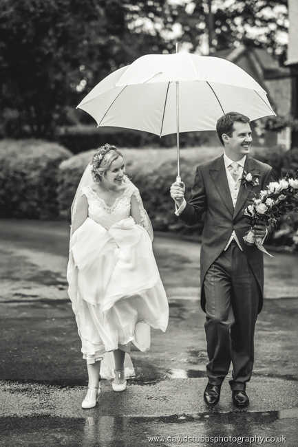 wedding couple out int he rain