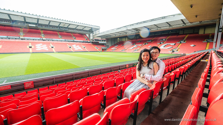 engaged couple in anfield stand