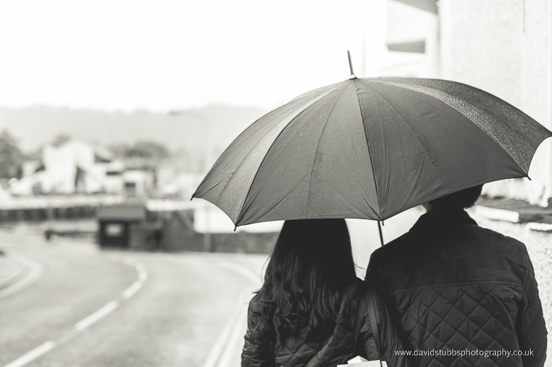 engagement couple umbrella