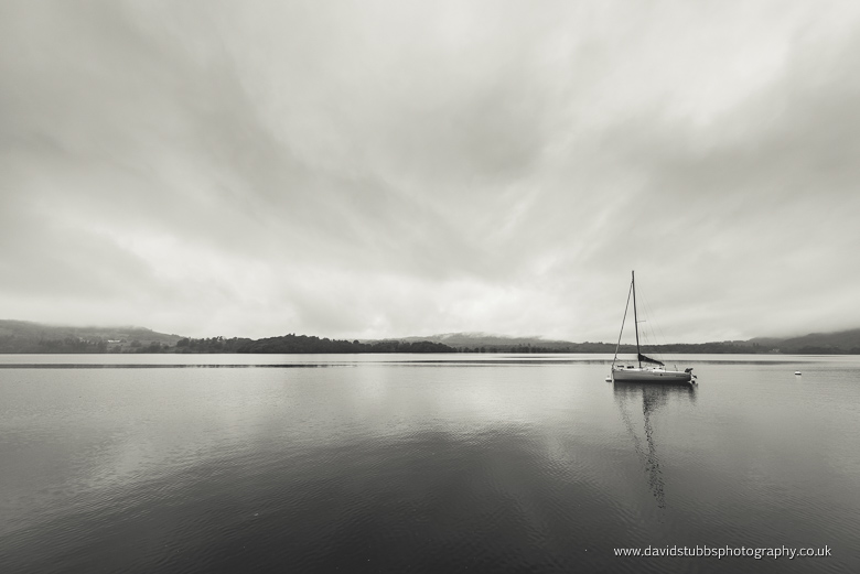 boat lake district black and white clouds