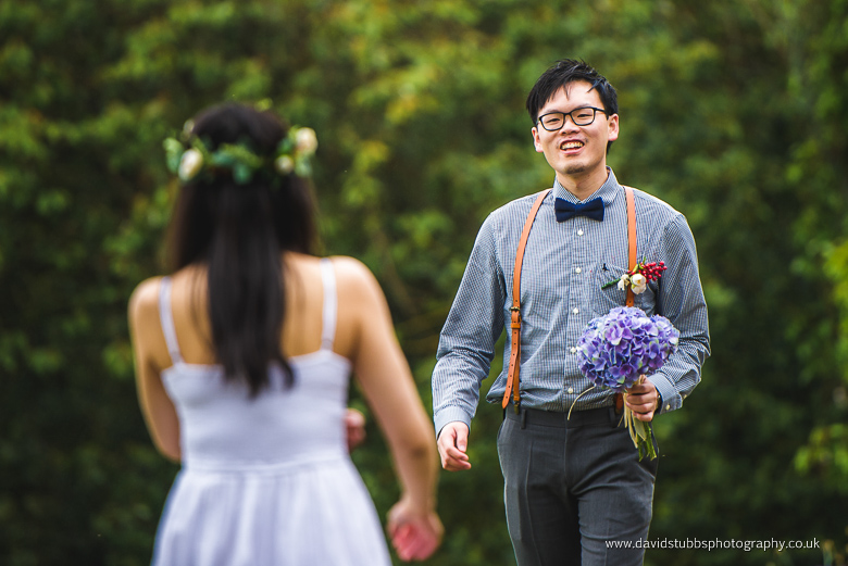 man approaches woman with flowers