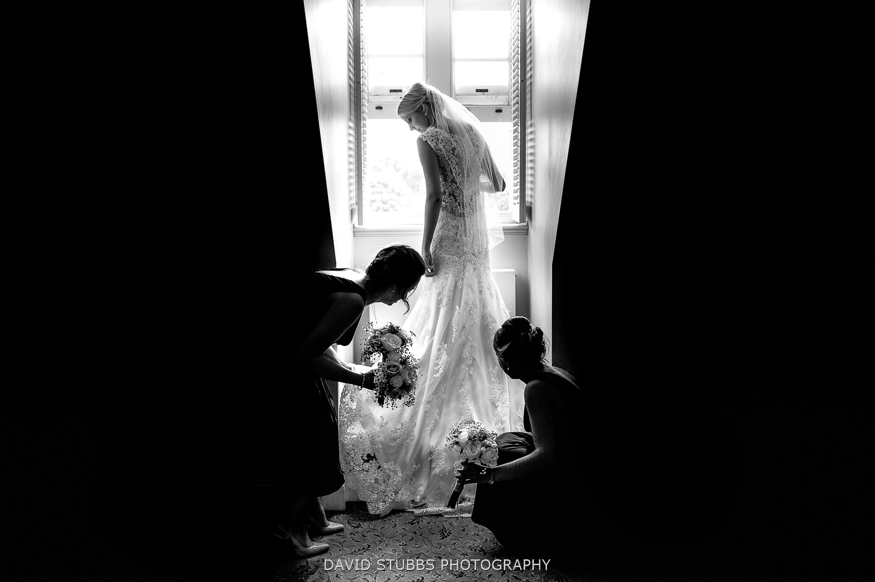fixing the dress in natural window light