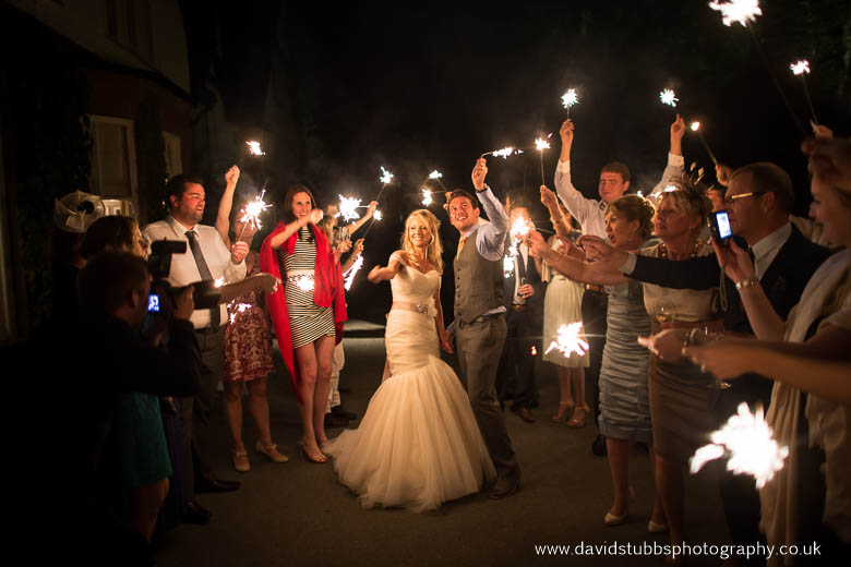 linthwaite house guests waving sparklers