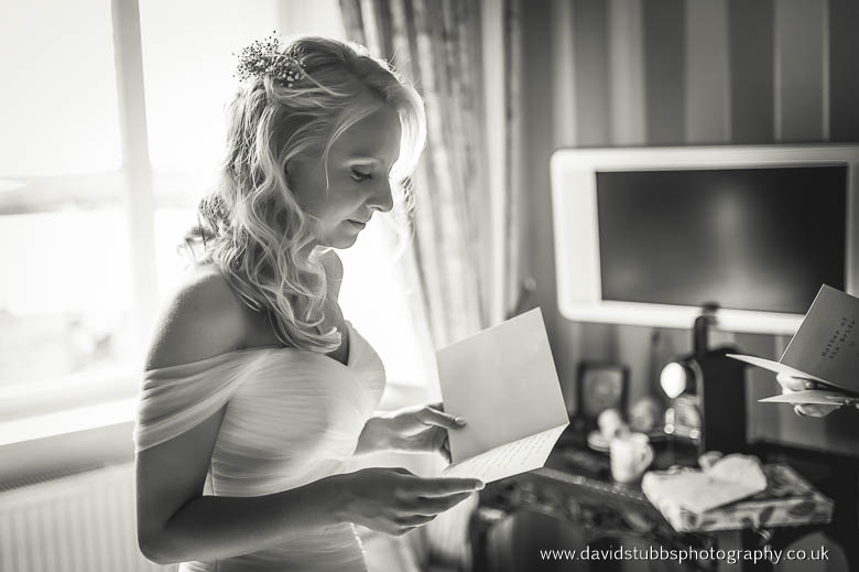 woman reading wedding card