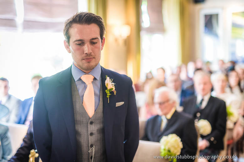 groom standing at the front