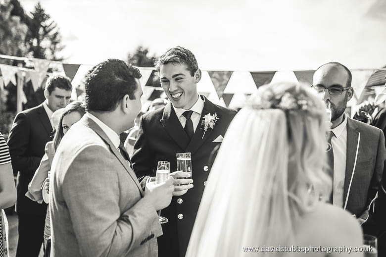 two men chatting and bride