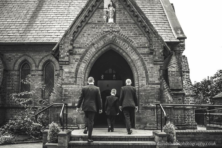 groom going into church