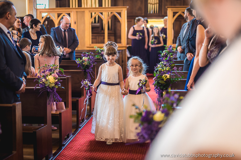 flower girls walking up the aisle