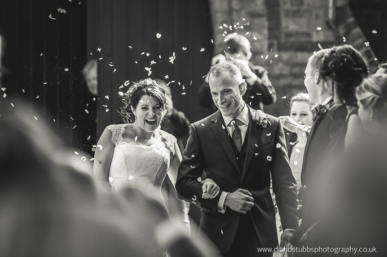 man and wife walking through confetti