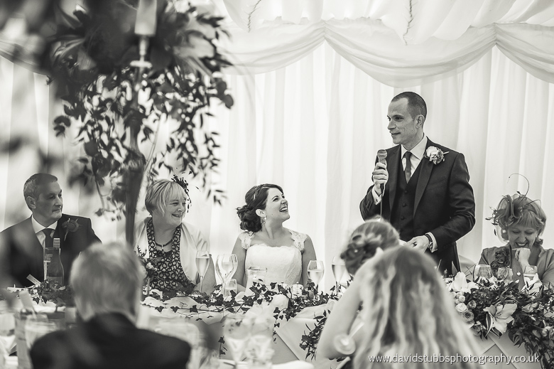 bride watching groom speech
