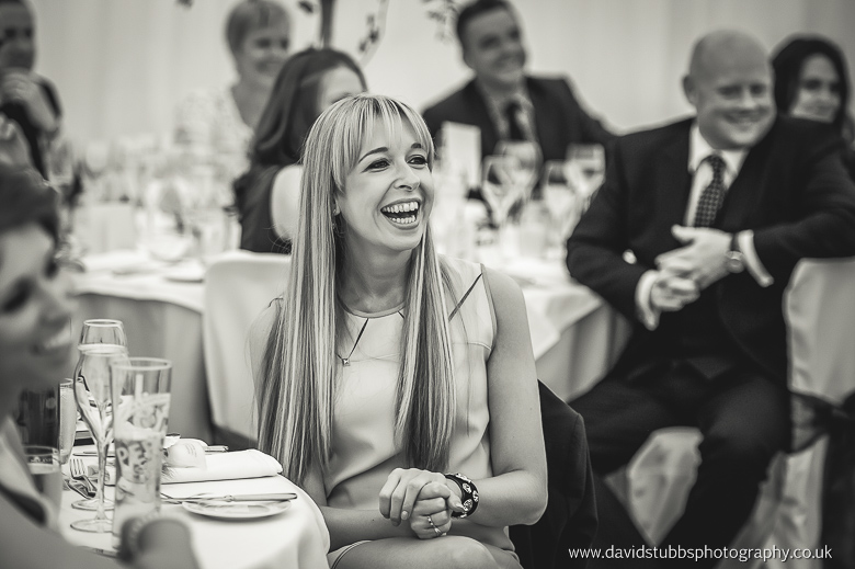 woman laughing at groom speech