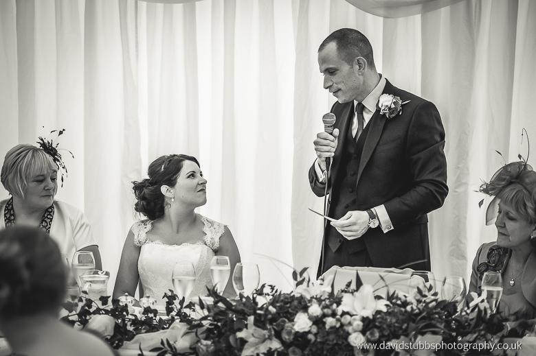 groom delivering speech to bride