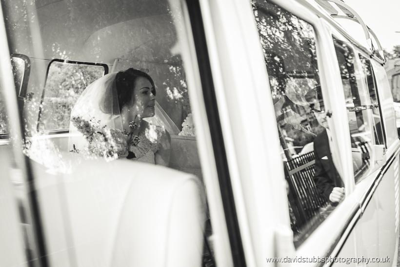 bride through window of VW campervan