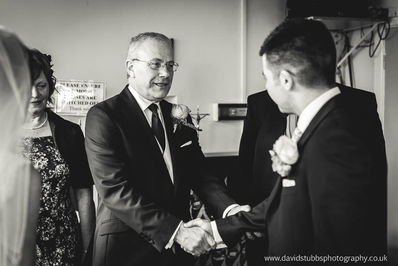 groom shaking mans hand