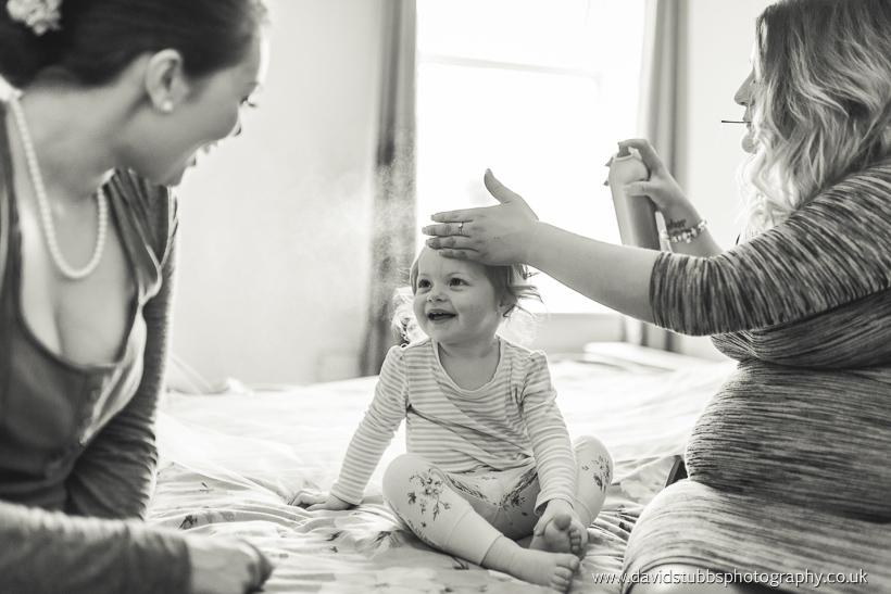 little girl having hair done