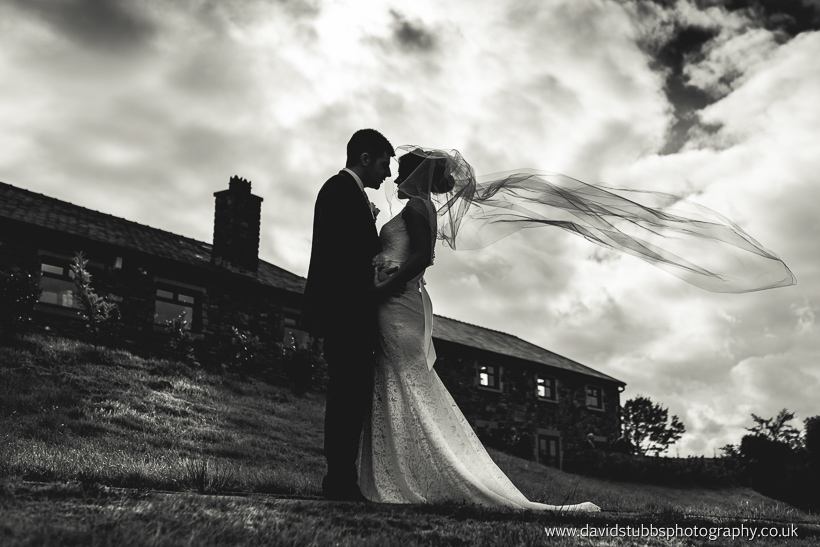 fishermans retreat bride and groom with veil blowing in the wind