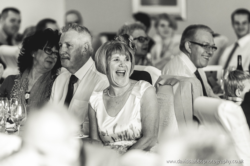 woman laughing at speeches