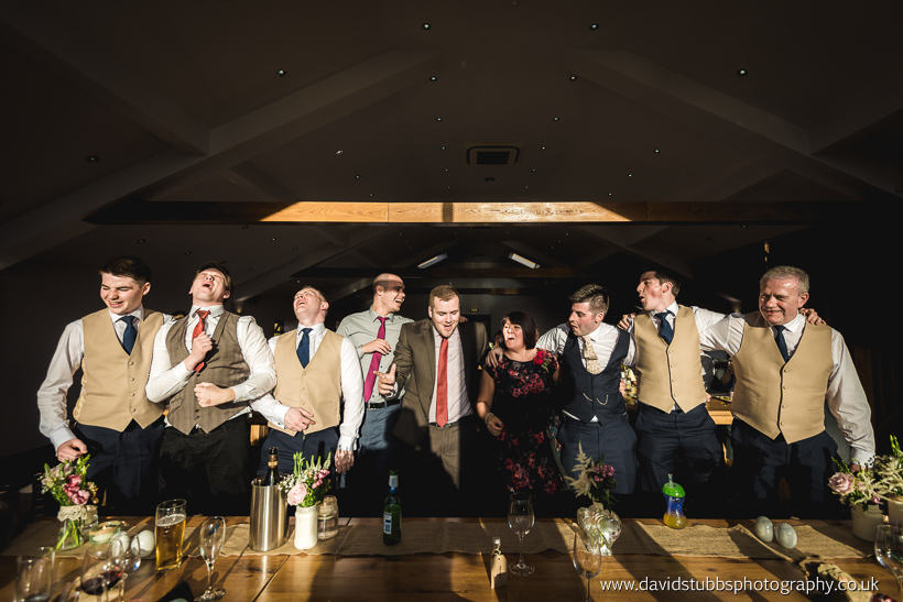 groom and guests dancing to singing waiters