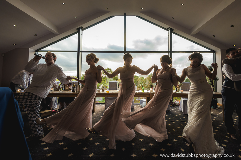 bridesmaids in a row by window