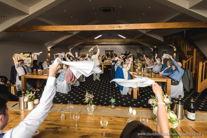 waving napkins in the air