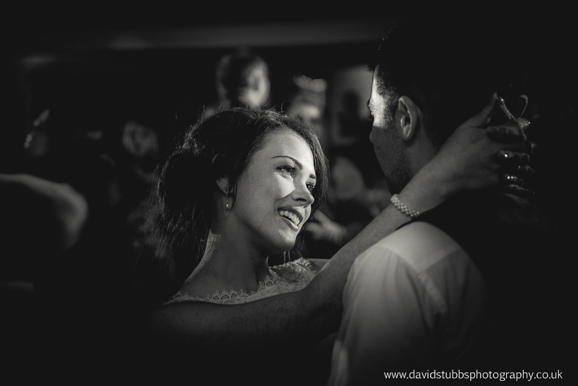 bride looking at husband black and white dance