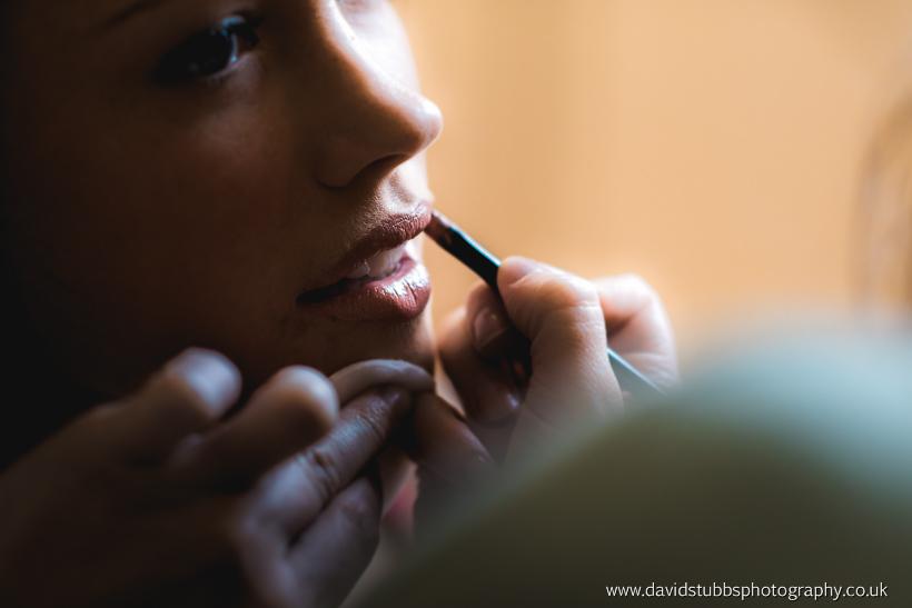 bride having lipstick applied photo